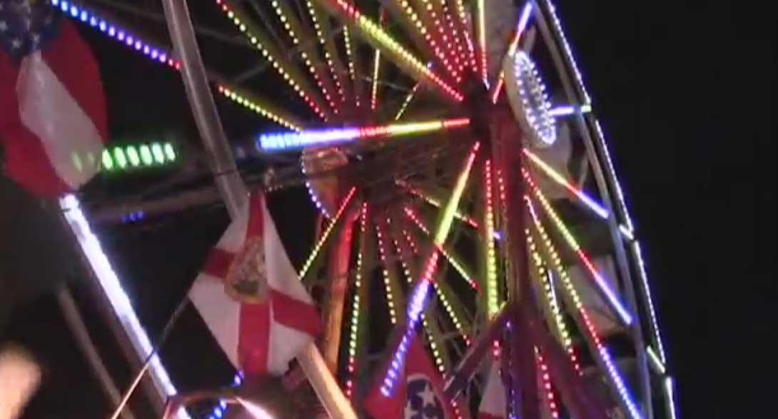 Ferris Wheel lights up the night.